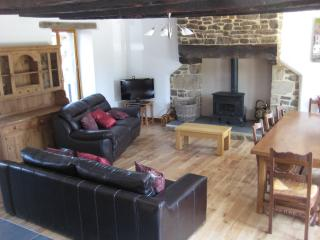 Gorgeous lounge with oak beams, leather settees, solid oak floor, log burner and oak dining table