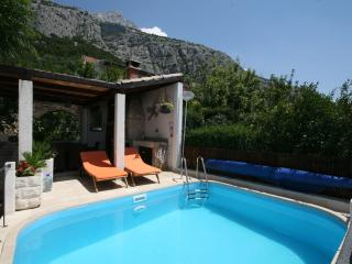 Outdoor swimming pool with sunloungers