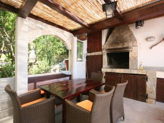 Covered terrace with dining set and fireplace