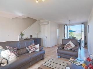 Spacious and modern living area leading out onto a private garden looking over fantastic views