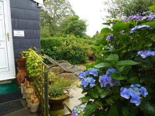 The paved garden is beautiful and private with many plants and birds............