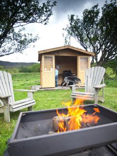 The summerhouse, gas BBQ and firepit area for you to enjoy