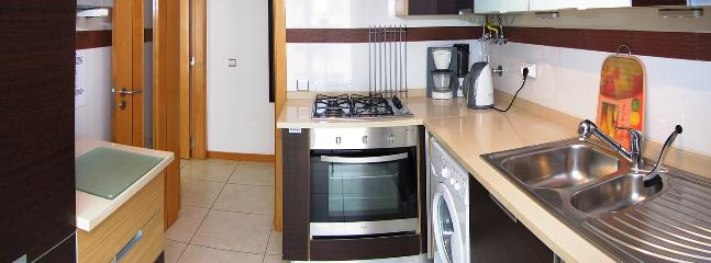 Fully equipped kitchen with gas Hob, electric Cooker, Dishwasher, Washing Machine, Fridge, Freezer