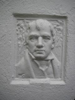 Walter Scott: stone feature on the front of the property.