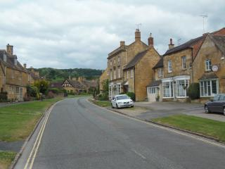 View of frontage of Upper High Street with Bay House on right