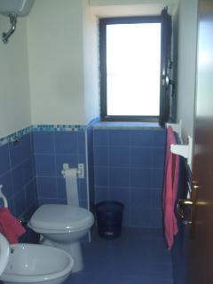 bathroom with a window on the sea