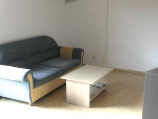Living area with 3 seater sofa bed