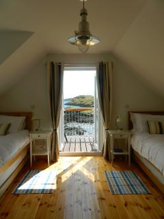 Wake up to a sea view, twin room with balcony overlooking South Harbour, Scalpay, Harris