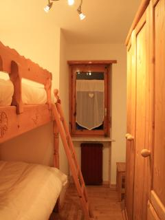 bedroom with regular bunk beds