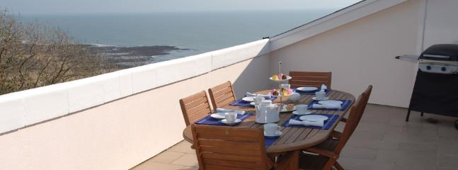Dining terrace with sea views