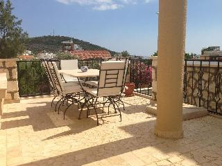 Large terrace overlooking the pool and views out towards Kalamar Bay