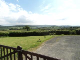 Merlin House view across garden to Brecon Beacons