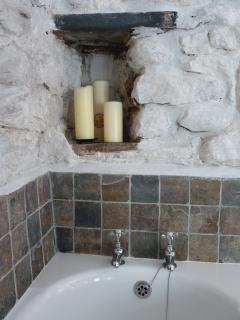 Light the candles and have a long soak after a day on the coast path!