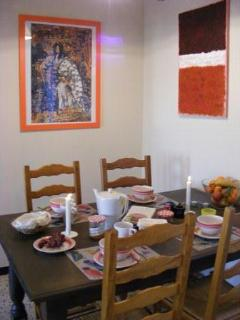The Dining Area next to the modern kitchen - all laid out for you to sit down and feast...