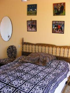 The African Bedroom on the ground floor with an en-suite bathroom and beautiful ocean view