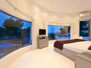 Master Suite And It's Curved Glass Windows At Dusk