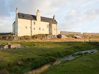 Beautiful Balnakeil House built on a cliff, on the beach