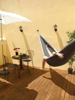 Sun terrace with hammock, table and chairs, sun hat and even outdoor shower to cool off in summer