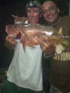 Captain Tony with 10lb red snapper.  Mmmmm. ..