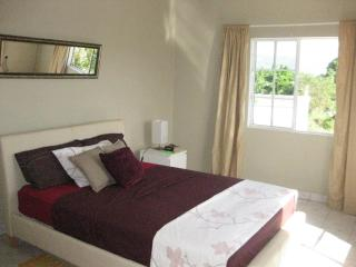 Master bedroom with king size bed and baby cot