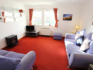 Cosy lounge with 2 settees complete with flatscreen TV; freeview channels and DVD player