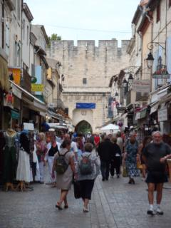 The main sreet as you enter Aigues-Mortes many shops cafes and restaurants