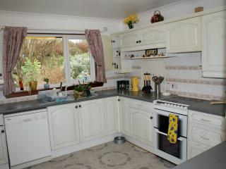 The kitchen is fully fitted and equipped with electric cooker with a double oven and grill, fridge.