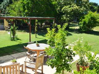 Pergola and terrace with dining table and chairs