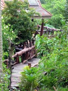 Private bridge entrance to villa