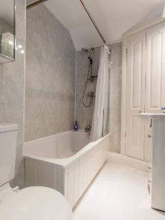 Bathroom with bath and power shower