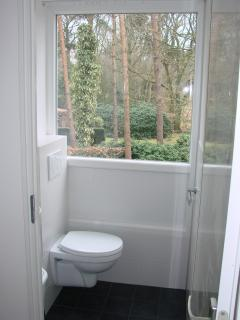 the toilet on the first floor with a view