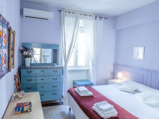 Air-conditioned bedroom with large double/2 single beds