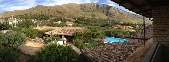 Pananoramic view to the pool and mountains