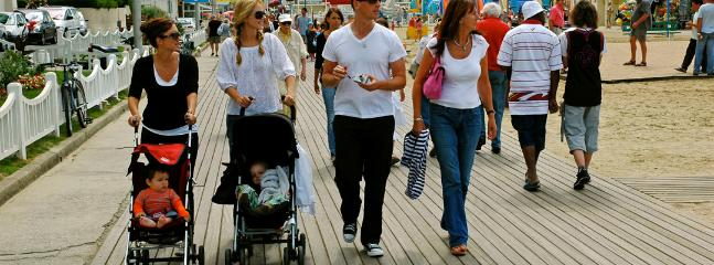 Guests walking off lunch on Trouville boardwalk