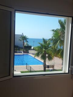 View of pool and sea from inside the master bedroom. This is what you wake up to.