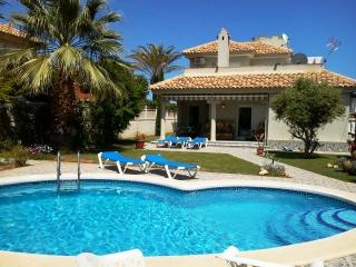 Relaxing garden with an outdoor pool, just 2 minutes walk walking distance to the beach