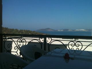 Enjoy your meal on the balcony with stunning views of the bay