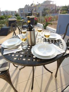 Patio with table, chairs and sun loungers