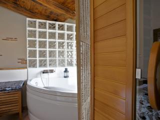 Jacuzzi y sauna en dormitorio