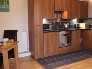 The fully fitted kitchen has intergrated appliances that even includes a dishwasher
