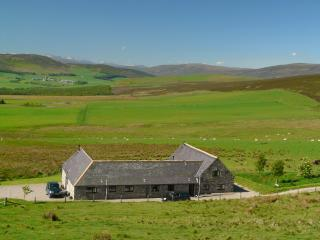 Bluefolds Steading  in the landscape with Aberlour cottage at centre. View to Cairngorm mountains