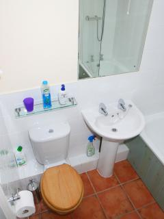 Bathroom, light and spacious with bath and shower
