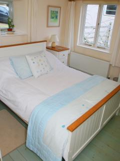 Master bedroom, large and spacious with second bed and en suite.