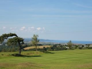Mill Cottage - Cosy holiday cottage overlooking golf course and to the Atlantic
