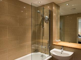 Modern en suite with bath and electric shower over.