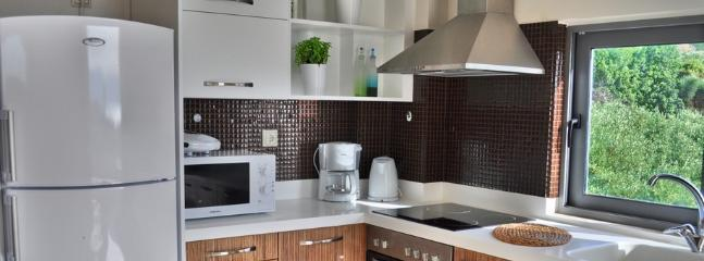 Fully equipped kitchen with views to the olive grove