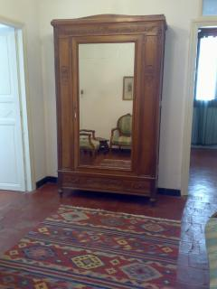 Mirrored wardrobe in suite's spacious entry hall