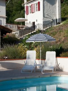 Petit Gite with terrace overlooking the swimming pool and mountains beyond