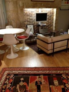 living/dining area (Le Corbusier sofa and Eero Saarinen Tulip table and chairs)
