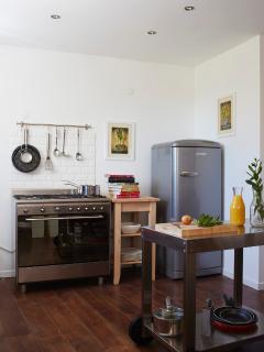 Kitchen area, range oven, microwave, dishwasher, washing machine, coffee maker,